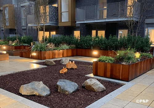Image shows a fabulous landscaped podium with planters serving luxury residences at the Essex Brewery redevelopment.