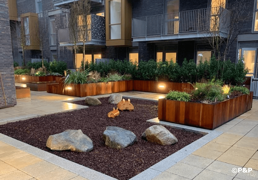 Image shows a fabulous landscaped podium with planters serving luxury residences at the Essex Brewery redevelopment in Walthamstow, London.