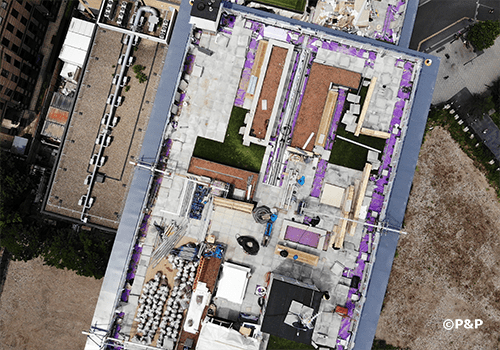 Image shows aerial photograph of work in progress on roof terrace at Carolyn House, Croydon.