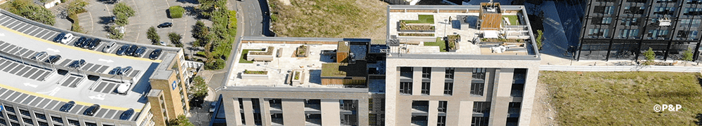 Banner image shows aerial photograph of three luxurious roof terraces at Carolyn House, Croydon. Showing planters, paving, decking, slate-top bar etc. all installed by the P&P team.