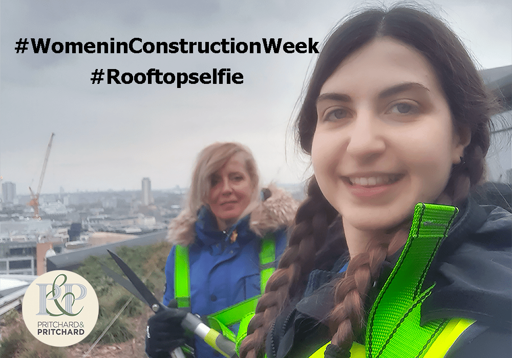 Two female living roof maintenance take a selfie on rooftop high above the city of London - Pritchard and Pritchard